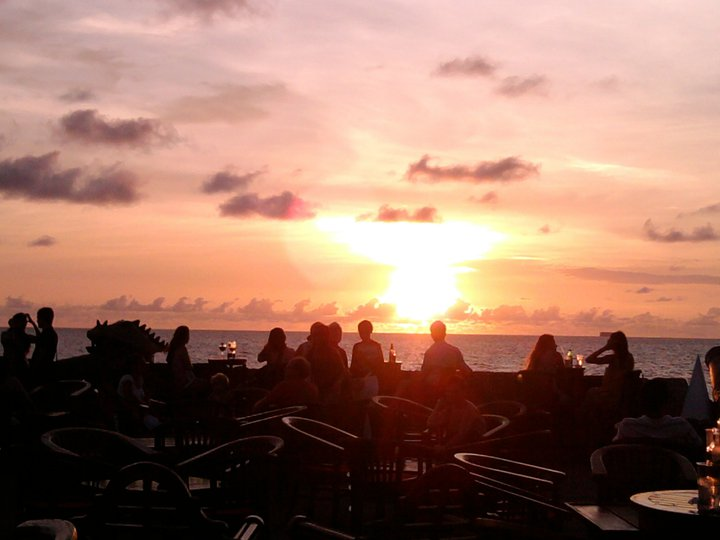 The sun sets over Cafe del Mar