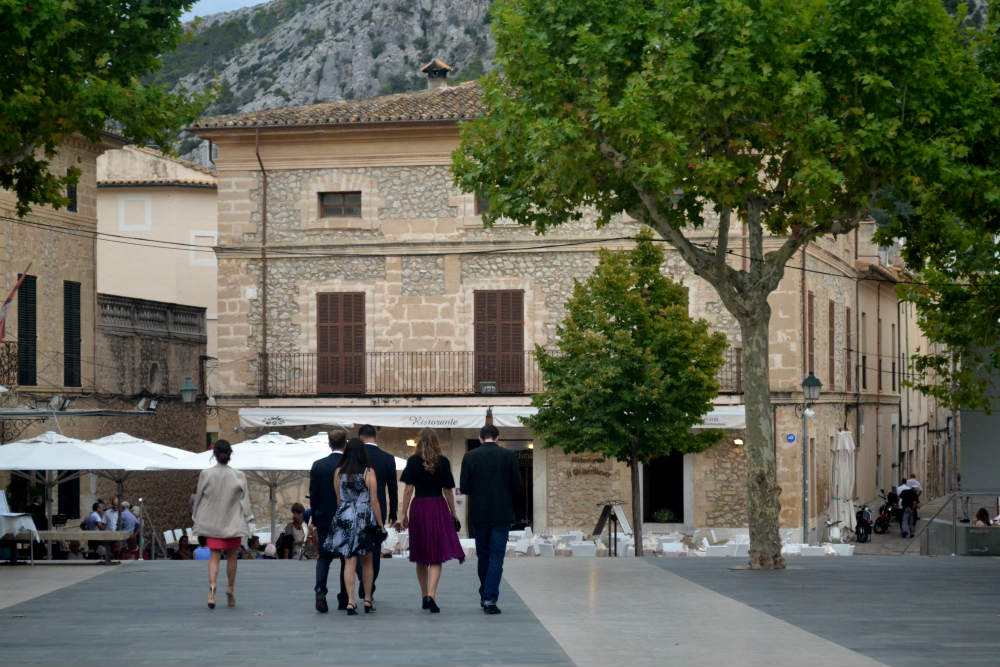 Elegantly dressed locals crossing the plaza