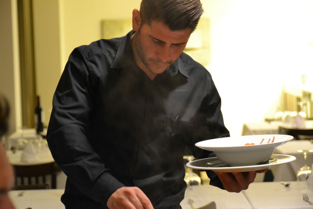 Serving up the caldereta aka lobster stew