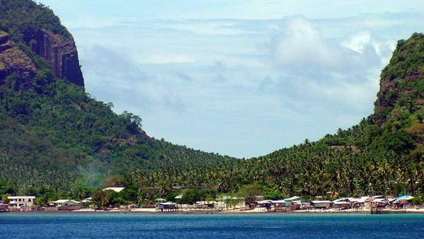 apulit-island-beachfront-with-two-limestone-mountains-in-background