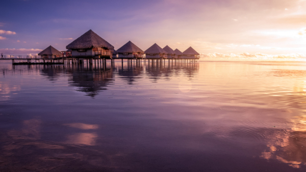 luxury-tahitian-villas-suspended-above-the-pacific-ocean-during-sunset