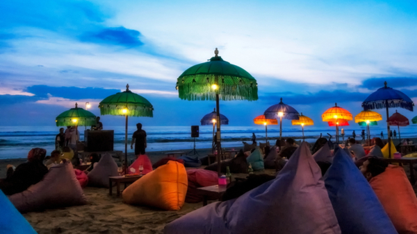 stunning-sunset-on-bali-beach-with-beanbags-and-lamps