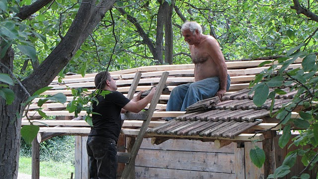 Fixing a roof at the Ethnographical museum