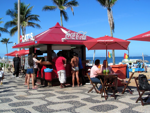 Enjoy your food and refreshing coconut water on the beach in Rio   Credit: Daytours4u
