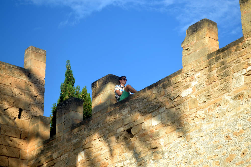 Relaxing on Alcudia's city walls
