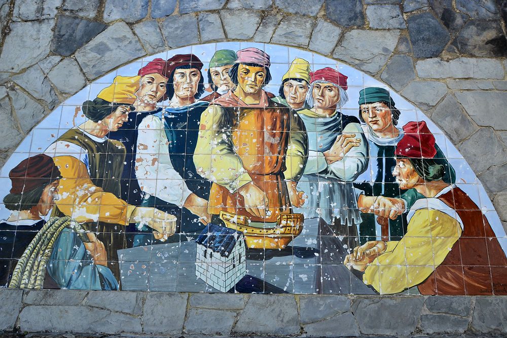 A mural above the table depicts life of old...