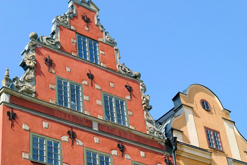 The sun strikes the facades of Gamla Stan