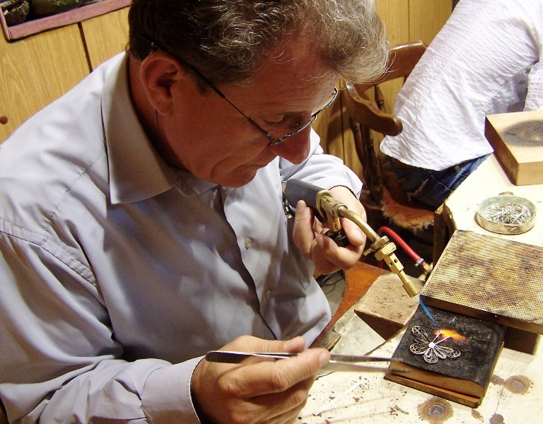 Skopje's Old Town is full of small shops, where artisans like this diligent silversmith keep up traditional crafts (Photo: Chris Deliso)