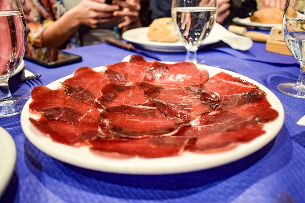 Crimson slivers of cecina