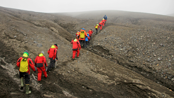 line-of-people-in-red-climbing-gear-hiking-deception-island