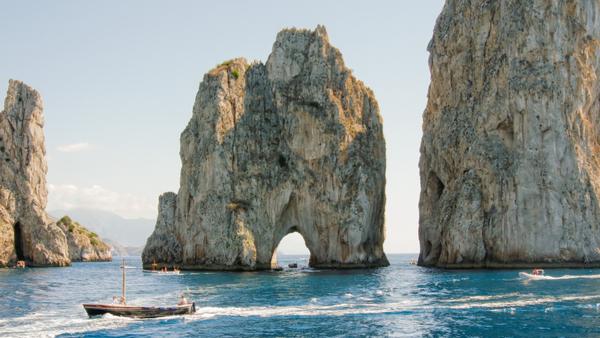 faraglioni-cliffs-capri-italy-with-blue-sea-and-sky