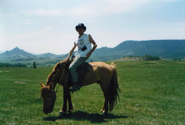Riding one of Mongolia's fastest horses > office work