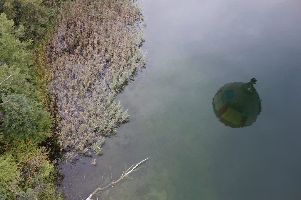 hot air balloon reflection lake trakai